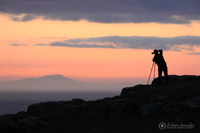 A Photographer Taking a Picture of the Sunset