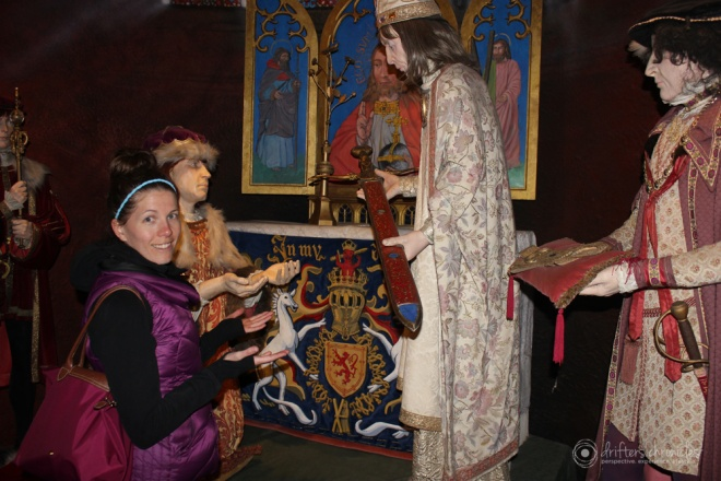Charlene is being knighted inside the castle